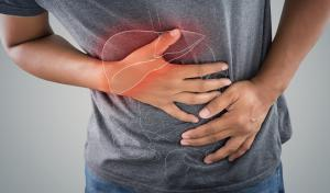 The-photo-of-large-intestine-is-on-the-man's-body-against-gray-background-People-With-Stomach-ache-problem-concept-Male-anatomy